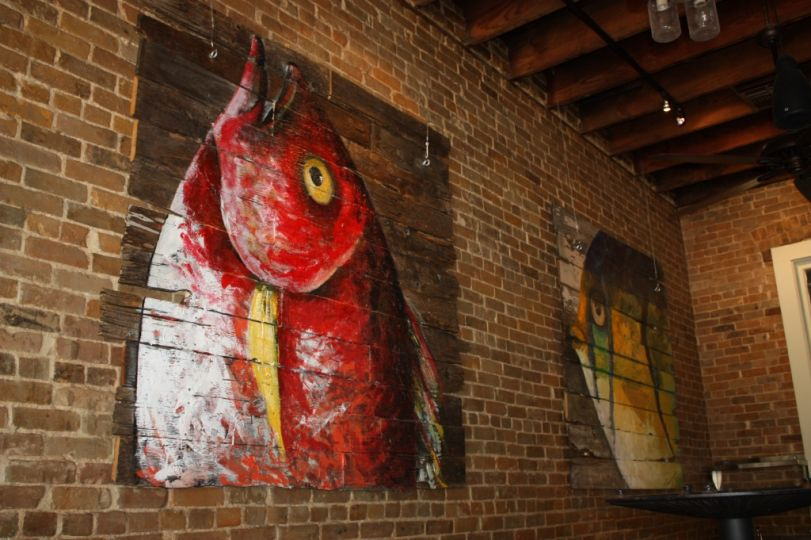 One of the bold fish paintings that hangs on the establishment's walls.