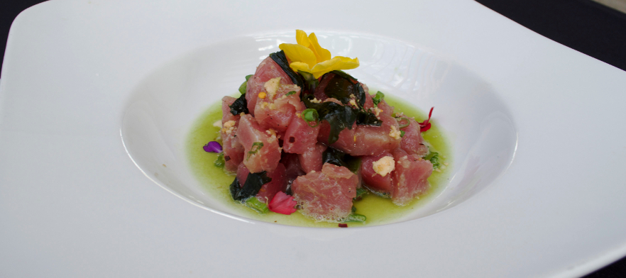A delicious tuna dish accented with flowers.