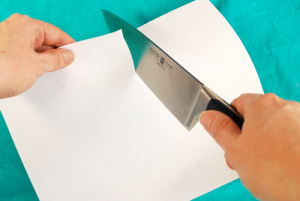 sharp knife cutting through paper