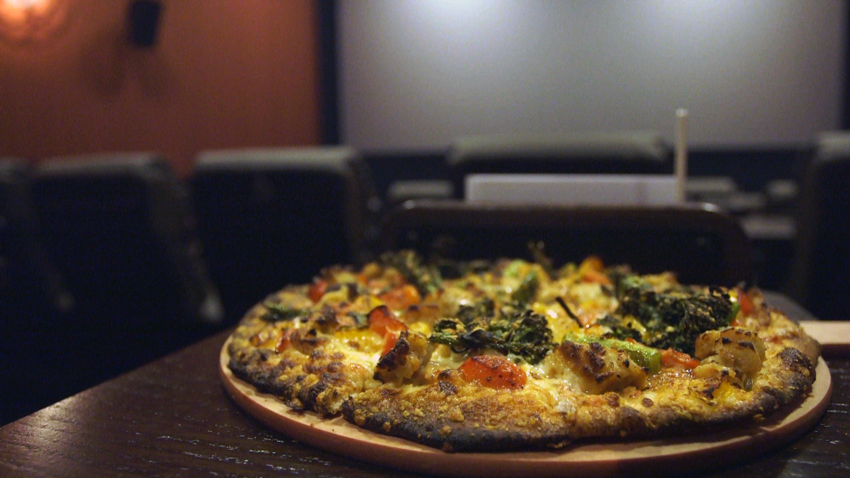 Hot, fresh-out-of-the-oven pizza served up seat side.