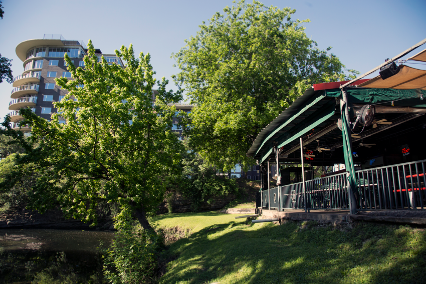 The Saloon's sun-kissed back patio looks out over beautiful Shoal Creek in downtown Austin.