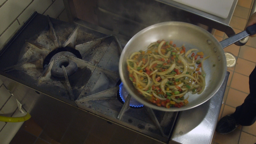 Fresh, flavorful Sautéed vegetables are on repeat at AISD. Heavy-duty cooktops in the AISD kitchens help keep up with the school's large food volumes