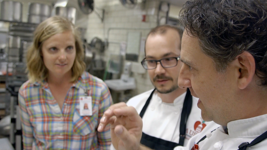 The Chef and his team discuss menu plans and preparations.