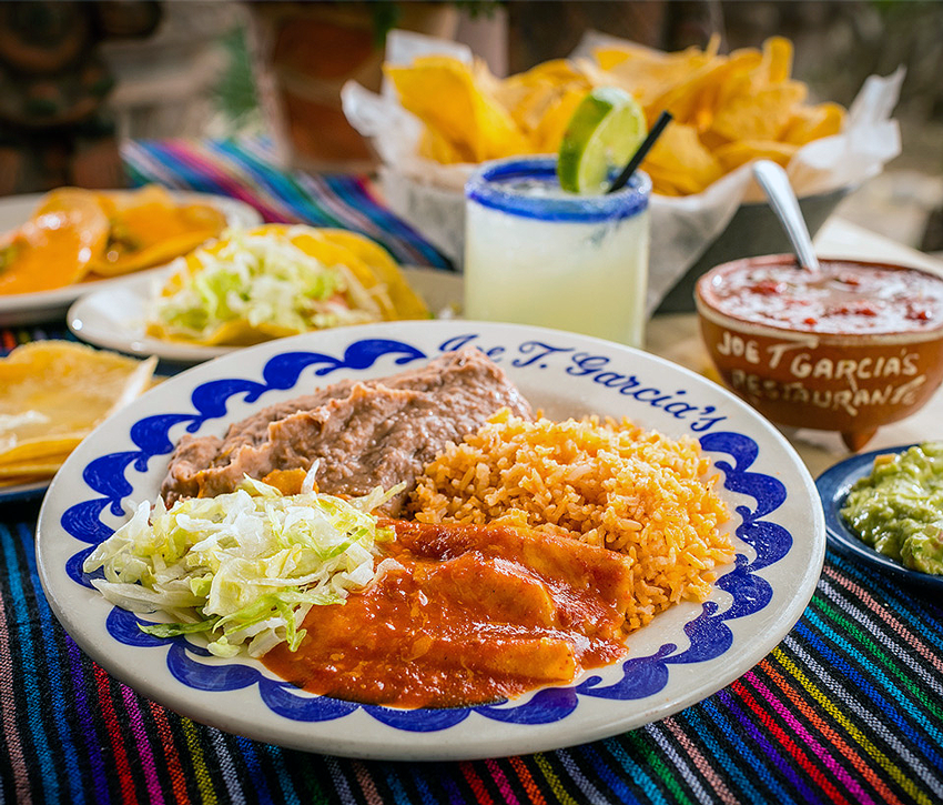 Delicious enchiladas round out the family style plate that is served all day. (Photo courtesy joetgarcias.com)