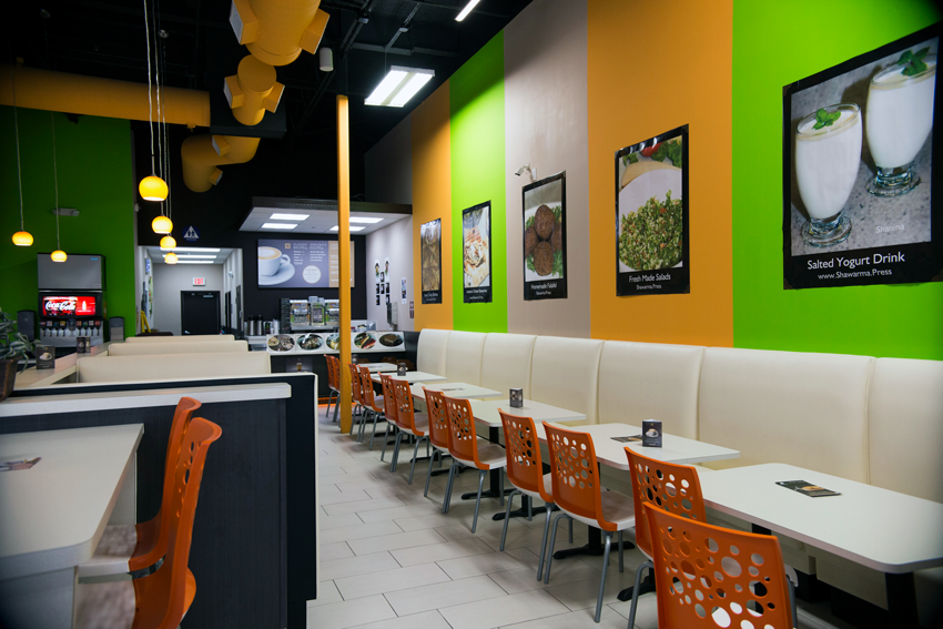 Bright, contemporary interiors give off a cheerful vibe at Shawarma Press.