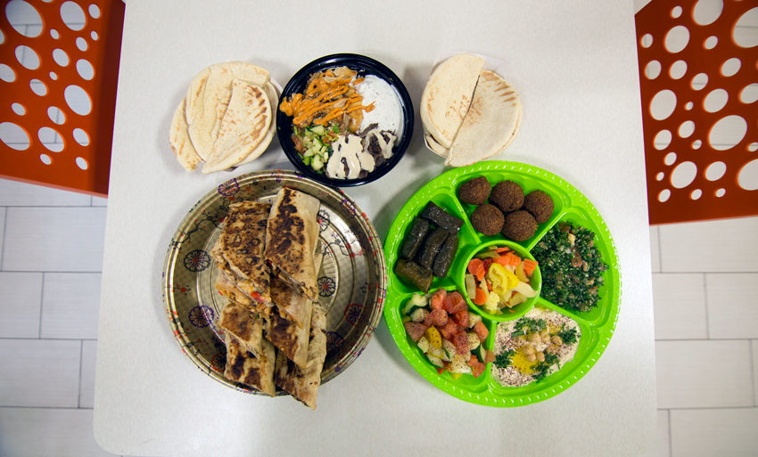 A medley of menu favorites, like Tabbouleh, Grape Leaves, Hummus and Pita Breads.