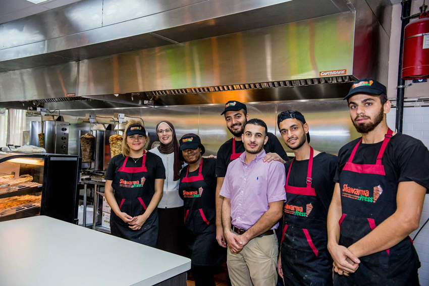 Team Shot: Sawsan and her team gather together in the kitchen.