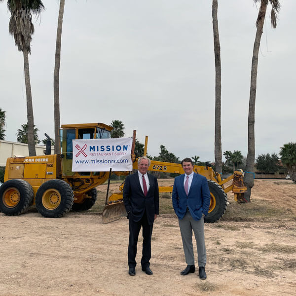 Jack Lewis and A.J. Lewis at the site of the groundbreaking for the new McAllen store location.