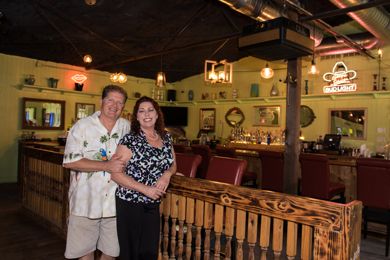 Donna Thompson—the proprietor of Legend's Music Venue—stands with her husband, Stan.