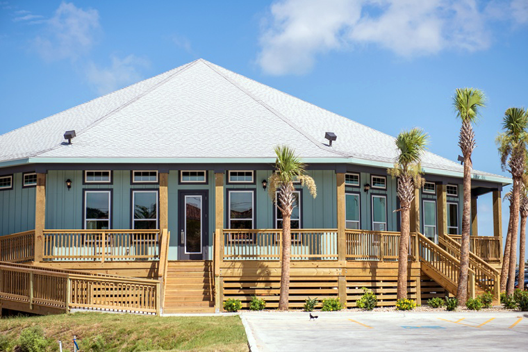 Palm trees flank the entrance of the dome-shaped restaurant.