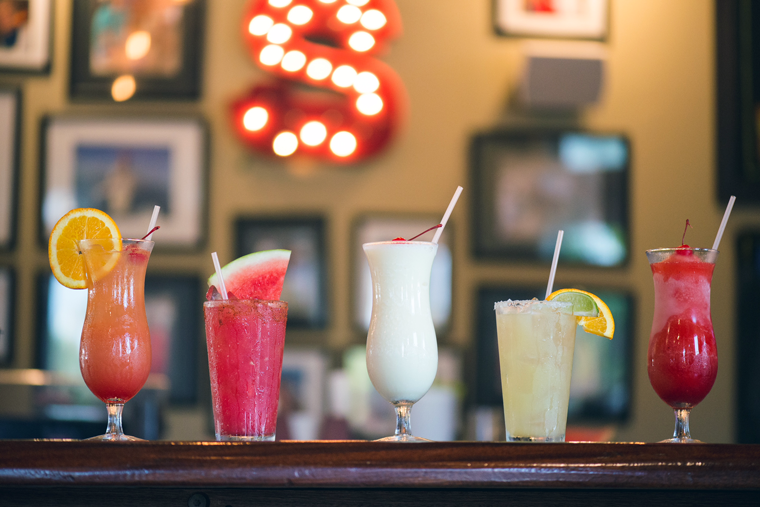 Behind the bar, exotic drinks give off a tropical, beachy-vibe.