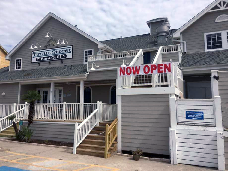 Outside Trout Street Bar & Grill, now open for business post-Hurricane Harvey. Photo via MySA.com.