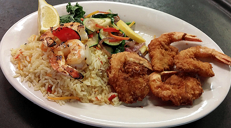 The restaurant prides itself on serving local-caught seafood, and the menu is full of different preparations, including the popular fried shrimp.  Photo via Trout Street Bar & Grill.